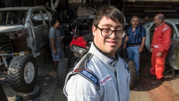 smiles at a mechanics workshop in Lima, on December 18, 2018, where his car is being prepared to take part in the upcoming Rally Dakar on January 2019. - Lucas Barron will make history on January 6 when he lines up on the Dakar 2019 start line in Peru, the first person with Down Syndrome to take part in the gruelling race. The 25-year-old, who will be co-pilot for his father Jacques, will tackle the world's most demanding rally: a 5,000 kilometer (3,000 miles), 10-day marathon, 70 percent of which will be raced over sand. (Photo by ERNESTO BENAVIDES / AFP) (Photo credit should read ERNESTO BENAVIDES/AFP/Getty Images)