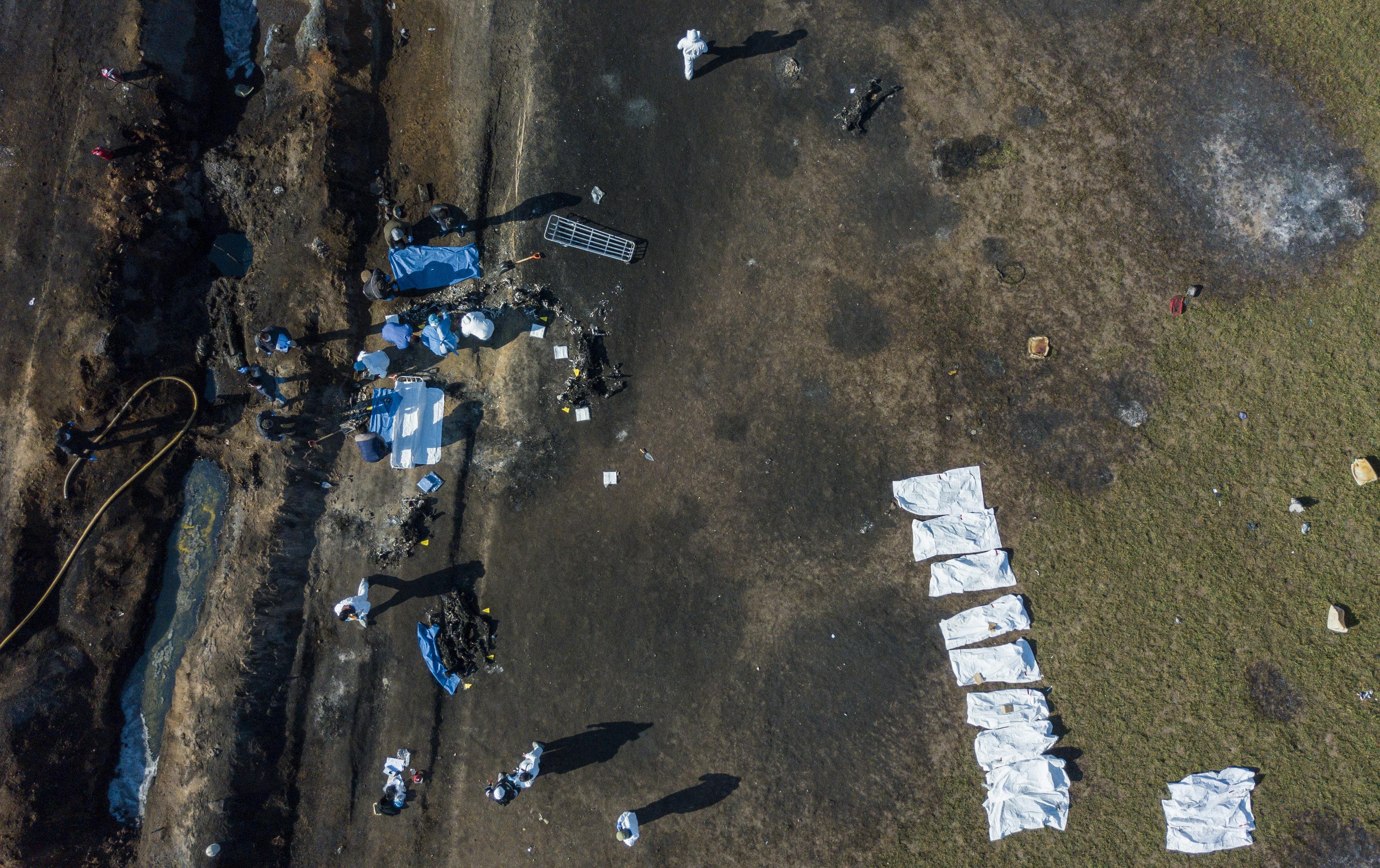 TOPSHOT - EDITORS NOTE: Graphic content / Aerial view of the scene where a massive blaze trigerred by a leaky pipeline took place the night before in Tlahuelilpan, Hidalgo state, Mexico on January 19, 2019. - An explosion and fire has killed at least 66 people who were collecting fuel gushing from a leaking pipeline in central Mexico, the Hidalgo state governor said on Saturday. (Photo by ALFREDO ESTRELLA / AFP) (Photo credit should read ALFREDO ESTRELLA/AFP/Getty Images)