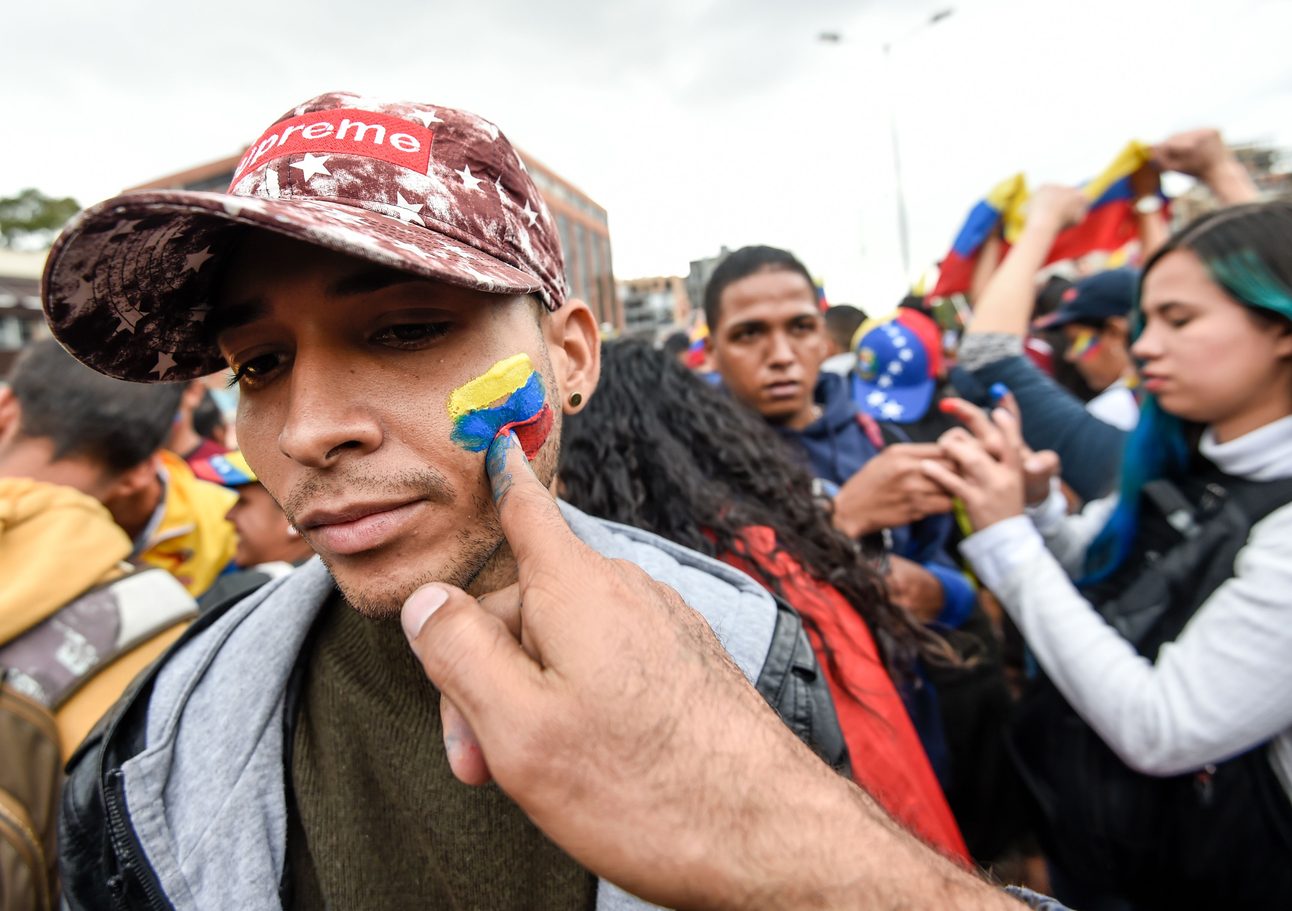 Venezuelans opposed to President Nicolas Maduro hold a demonstration in Bogota, Colombia in support of opposition leader Juan Guaido's self-proclamation as acting president of Venezuela, on January 23, 2019. (Photo by Juan BARRETO / AFP) (Photo credit should read JUAN BARRETO/AFP/Getty Images)