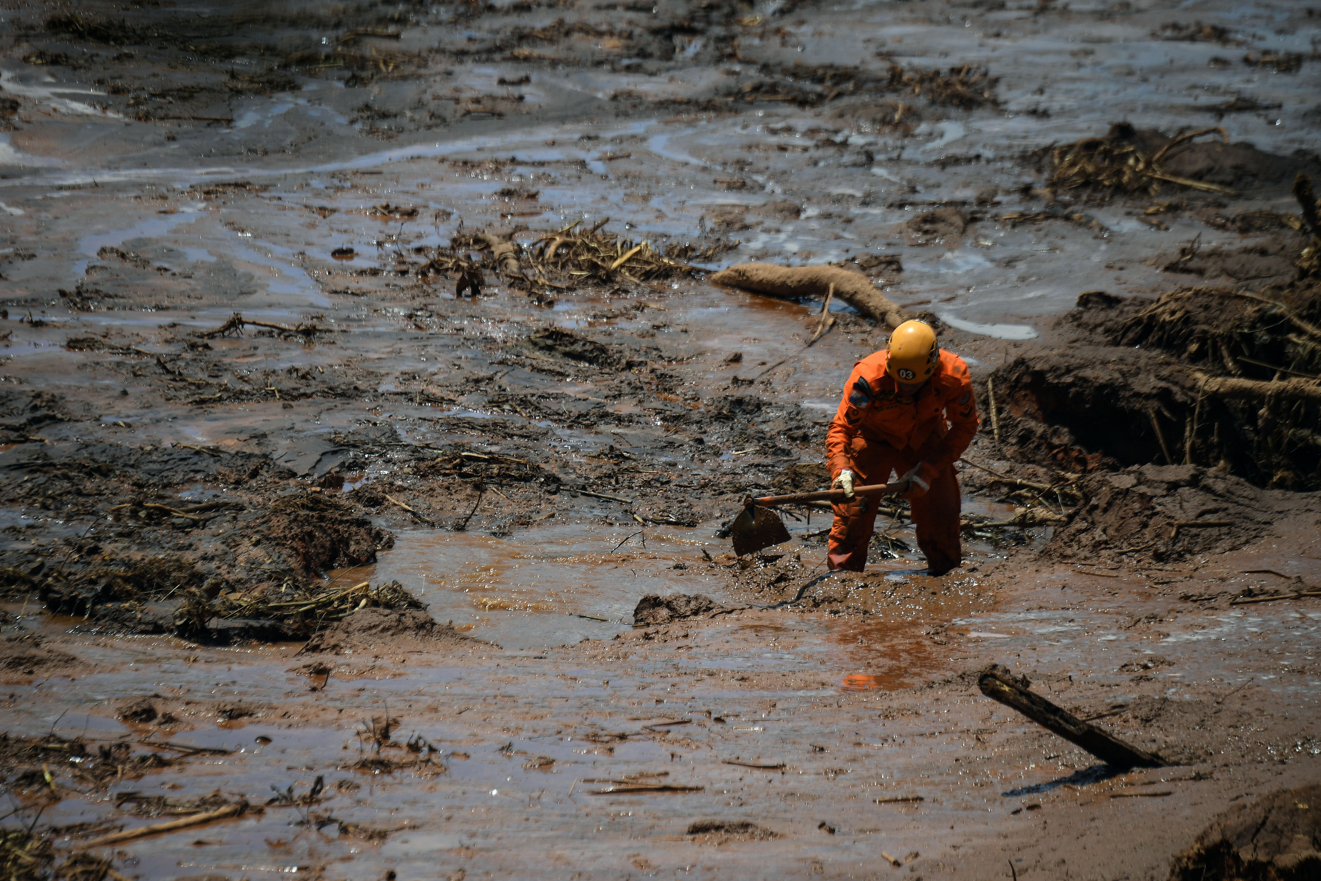 A rescuer works in the search for victims, four days after the collapse of a dam at an iron-ore mine belonging to Brazil's giant mining company Vale near the town of Brumadinho, state of Minas Gerias, southeastern Brazil, on January 28, 2019. - The search for survivors intensified on Monday, on its fourth day, with the support of an Israeli contingent, after communities were devastated by a dam collapse that killed at least 60 people at a Brazilian mining complex -- with hopes fading for 292 still missing. A barrier at the site burst on Friday, spewing millions of tons of treacherous sludge and engulfing buildings, vehicles and roads. (Photo by Mauro Pimentel / AFP) (Photo credit should read MAURO PIMENTEL/AFP/Getty Images)