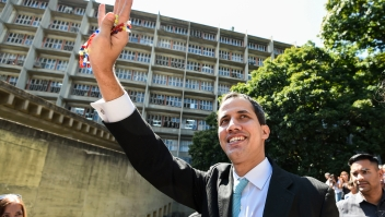 "Opposition leader and self-proclaimed ""acting president"" Juan Guaido arrives at Venezuela's Central University (UCV) in Caracas to present his government's plan on January 31, 2019. - Venezuela's self-proclaimed acting president Juan Guaido ruled out the possibility of civil war in his country, saying the overwhelming majority of his compatriots wanted Nicolas Maduro to step down. In an interview to Spain's El Pais newspaper published Thursday, Guaido repeated an appeal to Venezuela's armed forces to take his side. (Photo by JUAN BARRETO / AFP) (Photo credit should read JUAN BARRETO/AFP/Getty Images)"