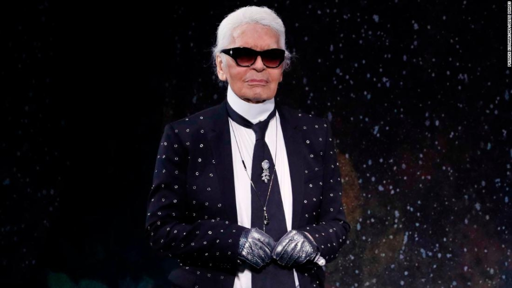 German fashion designer Karl Lagerfeld acknowledges the audience at the end of Fendi 2017-2018 fall/winter Haute Couture collection in Paris on July 5, 2017. (Photo by Patrick KOVARIK / AFP) (Photo credit should read PATRICK KOVARIK/AFP/Getty Images)