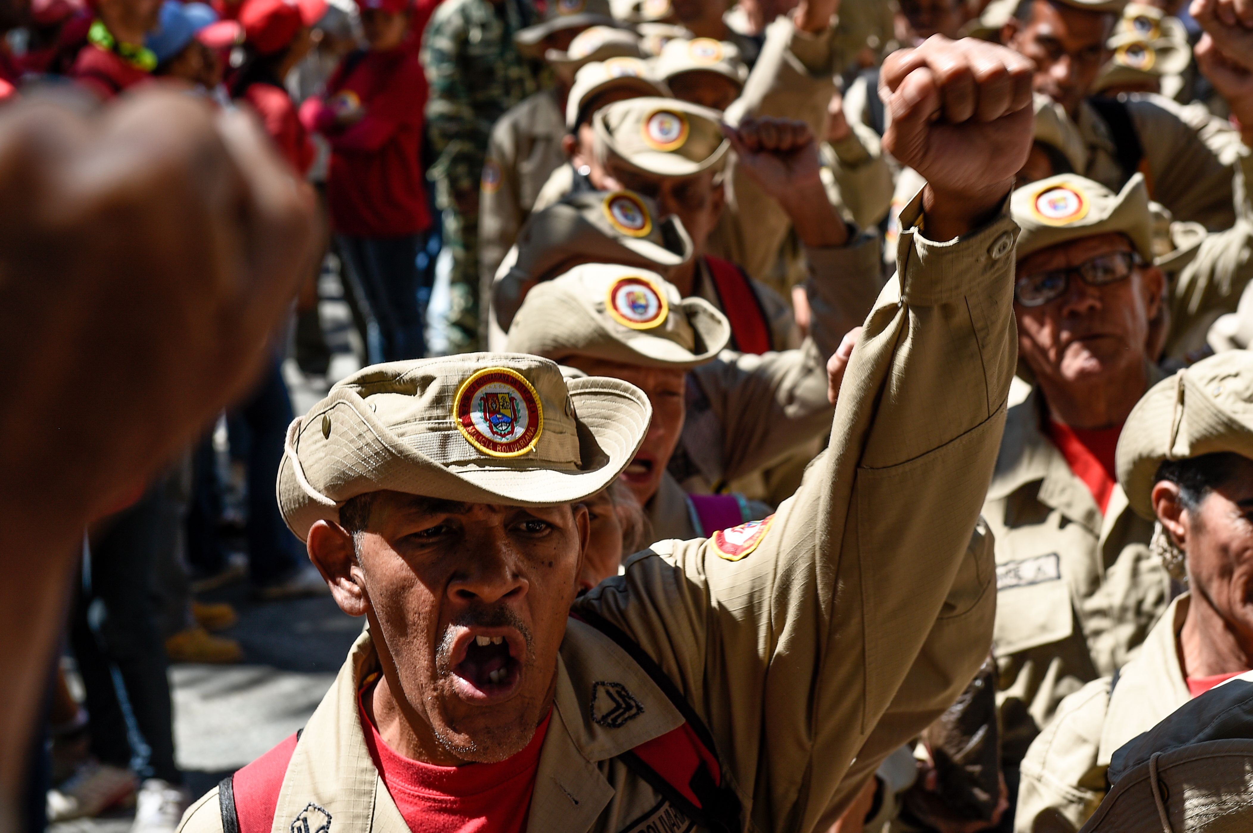 "Members of Venezuela's Bolivarian militia demonstrate in support of President Nicolas Maduro during a commemoration for the ""27th Anniversary of the Military Rebellion of the 4FEB92 and National Dignity Day"", at Bolivar Square in Caracas, on February 4, 2019. - The United Nations will not join any group of nations promoting initiatives to resolve the crisis in Venezuela, the UN chief said Monday, indicating he will not attend a meeting in Uruguay this week of several countries. Mexico and Uruguay had hoped that UN Secretary-General Antonio Guterres would attend a conference in Montevideo on Thursday aimed at promoting dialogue between Venezuela's President Nicolas Maduro and opposition leader Juan Guaido. (Photo by Federico PARRA / AFP)        (Photo credit should read FEDERICO PARRA/AFP/Getty Images)"