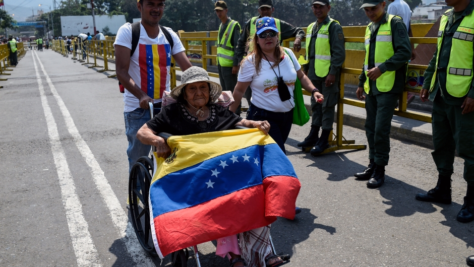 "Venezuelans cross the Simon Bolivar International Brige from San Antonio del Tachira in Venezuela, to attend the ""Venezuela Aid Live"" concert on the Colombian side of Tienditas International Bridge in Cucuta, Colombia on February 22, 2019. - Thousands of people, many waving Venezuelan flags, streamed into a concert site on the Venezuela-Colombia border Friday for an international charity concert to push for humanitarian aid deliveries in defiance of a blockade by the government of President Nicolas Maduro. (Photo by Federico Parra / AFP) (Photo credit should read FEDERICO PARRA/AFP/Getty Images)"