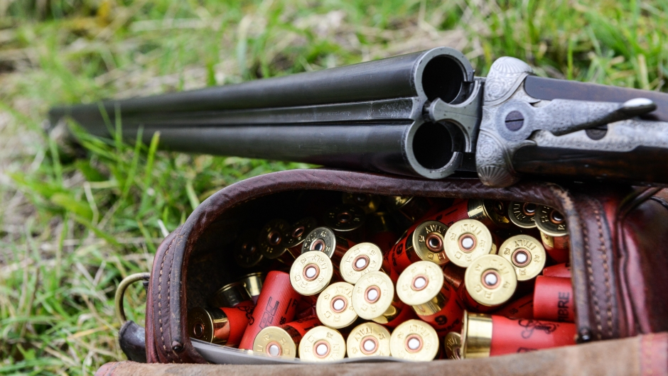 """OXFORDSHIRE, ENGLAND - OCTOBER 23: A gun and cartridges at a pheasant and partridge shoot on October 23, 2015 in Oxfordshire, England. The UK pheasant shooting season begins on October 1st, 2015 and ends on February 1st, 2016. During the season around 50 million game birds are released for shooting, the sport shooting industry is worth an estimated £1.6 billion to the British economy. The most common type of game bird shoot is """"driven shooting"""" where beaters drive the birds towards a line of stationary guns. (Photo by Chris Ratcliffe/Getty Images)"""