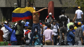 Supporters of Venezuelan opposition leader and self-proclaimed acting president Juan Guaido take part in a demonstration in Caracas on March 9, 2019. - Riot police blocked protesters as thousands of people took to the streets Saturday with tensions rising between opposition leader Juan Guaido and President Nicolas Maduro after crisis-wracked Venezuela emerged from the chaos of an electricity blackout. (Photo by YURI CORTEZ / AFP) (Photo credit should read YURI CORTEZ/AFP/Getty Images)