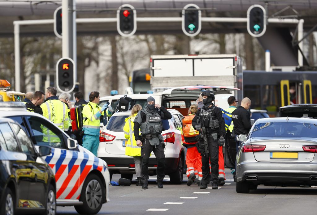 """TOPSHOT - Police forces stand at the 24 Oktoberplace in Utrecht, on March 18, 2019 where a shooting took place. - Several people were wounded in a shooting on a tram in the Dutch city of Utrecht on March 18, police said, with local media reporting counter-terrorism police at the scene. """"Shooting incident... Several injured people reported. Assistance started,"""" the Utrecht police Twitter account said. """"It is a shooting incident in a tram. Several trauma helicopters have been deployed to provide help."""" (Photo by Robin van Lonkhuijsen / ANP / AFP) / Netherlands OUT (Photo credit should read ROBIN VAN LONKHUIJSEN/AFP/Getty Images)"""