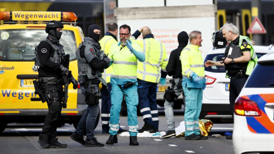 """Police forces and emergency services stand at the 24 Oktoberplace in Utrecht, on March 18, 2019 where a shooting took place. - Several people were wounded in a shooting on a tram in the Dutch city of Utrecht on March 18, police said, with local media reporting counter-terrorism police at the scene. """"A shooting occurred on the 24 Oktoberplein in Utrecht... Multiple people have been injured. The surrounding area has been cordoned off and we are investigating the matter,"""" Utrecht police said on Twitter. (Photo by Robin van Lonkhuijsen / ANP / AFP) / Netherlands OUT (Photo credit should read ROBIN VAN LONKHUIJSEN/AFP/Getty Images)"""