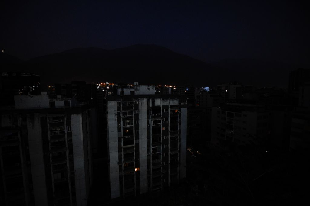 "View of pitch-dark buildings at Los Palos Grandes neighborhood, during a power outage in Caracas, Venezuela, on March 26, 2019. - Venezuela decreed a 24-hour holiday Tuesday to cope with a new near-nationwide blackout that the government alleged was caused by an ""attack"" targeting its main hydroelectric plant. (Photo by FEDERICO PARRA / AFP) (Photo credit should read FEDERICO PARRA/AFP/Getty Images)"
