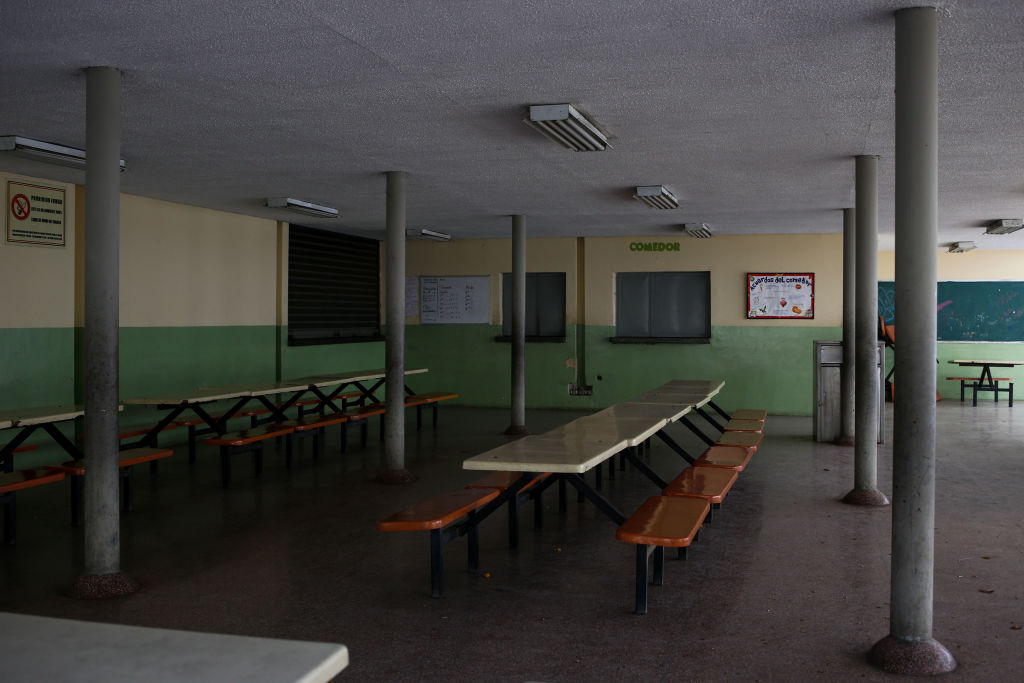 View of an empty school canteen in the Andres Bello educational complex in Caracas taken on March 27, 2019 during a power outage in Venezuela as a 24-hour closure of schools and workplaces has been extended another 24 hours to take a load off the grid. - Desperation and rage spreads among Venezuelans as the hours pass and the massive blackout that hits the country since Monday is not solved. A new blackout swept across Venezuela on Monday, including much of Caracas, sowing alarm two weeks after a nationwide outage that paralyzed the country. (Photo by Cristian HERNANDEZ / AFP) (Photo credit should read CRISTIAN HERNANDEZ/AFP/Getty Images)