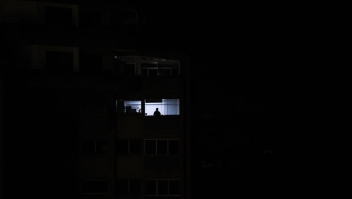 A man looks out of a window during a power outage in Caracas, Venezuela, on March 30, 2019. - Venezuelan security forces fired tear gas Saturday to disperse demonstrators in Caracas outraged by massive power outages that have kept much of the country in darkness since early March. (Photo by FEDERICO PARRA / AFP) (Photo credit should read FEDERICO PARRA/AFP/Getty Images)