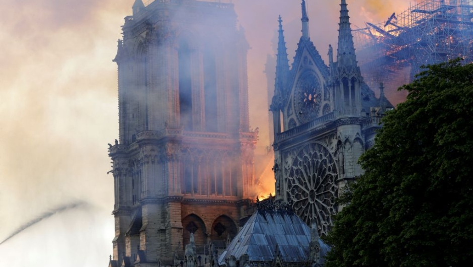 The landmark Notre-Dame Cathedral is engulfed by flames in central Paris on April 15, 2019. - A huge fire swept through the roof of the famed Notre-Dame Cathedral in central Paris on April 15, 2019, sending flames and huge clouds of grey smoke billowing into the sky. The flames and smoke plumed from the spire and roof of the gothic cathedral, visited by millions of people a year. A spokesman for the cathedral told AFP that the wooden structure supporting the roof was being gutted by the blaze. (Photo by Geoffroy VAN DER HASSELT / AFP) (Photo credit should read GEOFFROY VAN DER HASSELT/AFP/Getty Images)