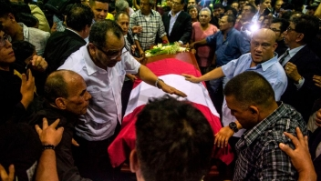 The coffin with the remains of late Peruvian former President Alan Garcia arrives to the American Popular Revolutionary Alliance (APRA) party headquarter's in Lima, on April 17, 2019. - Garcia, who was president from 1985-90 and again from 2006-11, died in hospital on April 17, 2019, after shooting himself in the head at his home as police were about to arrest him over the graft investigation. He was suspected of having taken bribes from Brazilian construction giant Odebrecht in return for large-scale public works contracts. (Photo by ERNESTO BENAVIDES / AFP) (Photo credit should read ERNESTO BENAVIDES/AFP/Getty Images)