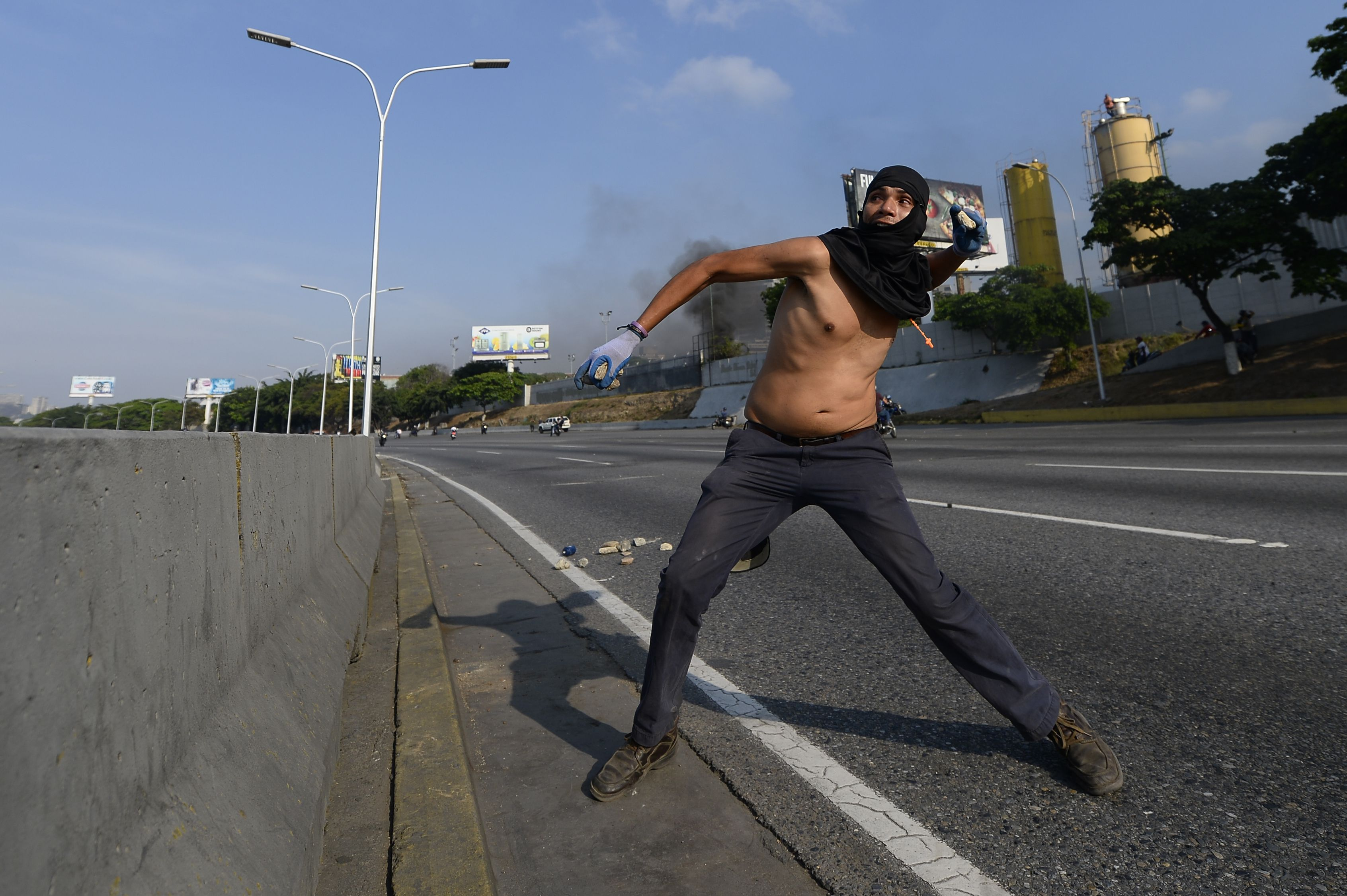 A Venezuelan clashes with security forces in Caracas on April 30, 2019. - Venezuelan opposition leader and self-proclaimed acting president Juan Guaido said on Tuesday that troops had joined his campaign to oust President Nicolas Maduro as the government vowed to put down what it said was an attempted coup. (Photo by Matias Delacroix / AFP) (Photo credit should read MATIAS DELACROIX/AFP/Getty Images)