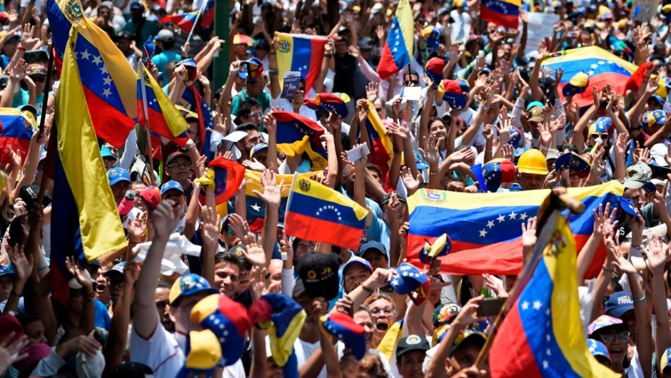 Anti-government demonstrators rally in Caracas to commemorate May Day on May 1, 2019 after a day of violent clashes on the streets of the capital spurred by Venezuelan opposition leader Juan Guaido's call on the military to rise up against President Nicolas Maduro. - Guaido called for a massive May Day protest to increase the pressure on President Maduro. (Photo by Federico PARRA / AFP) (Photo credit should read FEDERICO PARRA/AFP/Getty Images)
