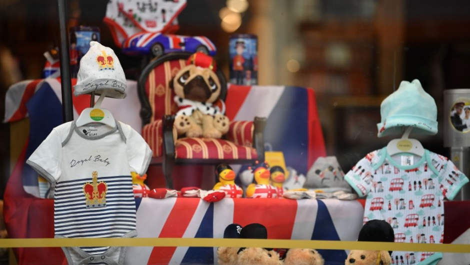 A Royal Baby outfit is pictured on display in a shop window as excitement builds in the town waiting for the birth of the child of Britain's Prince Harry and Meghan, Duke and Duchess of Sussex, on May 3, 2019. (Photo by Ben STANSALL / AFP) (Photo credit should read BEN STANSALL/AFP/Getty Images)