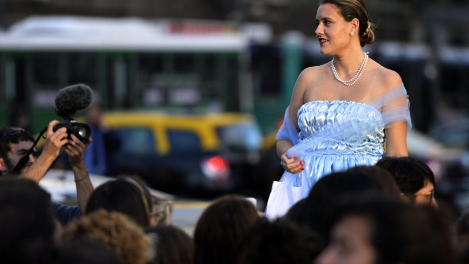 """A woman fancy dressed as former Argentina's First Lady (1946-1952) Eva Peron (1919-1952), poses at the Republic square during a demonstration in Buenos Aires on May 6, 2019. - May 7th marks the 100th anniversary of Eva Duarte de Peron's (Evita) birth, who was called the """"standard-bearer of the humble"""". (Photo by JUAN MABROMATA / AFP) (Photo credit should read JUAN MABROMATA/AFP/Getty Images)"""