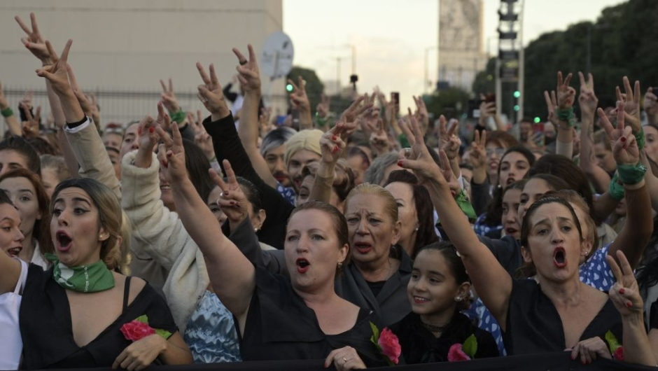 """Women fancy dressed as former Argentina's First Lady (1946-1952) Eva Peron (1919-1952), shout slogans at the Republic square during a demonstration in Buenos Aires on May 6, 2019. - May 7th marks the 100th anniversary of Eva Duarte de Peron's (Evita) birth, who was called the """"standard-bearer of the humble"""". (Photo by JUAN MABROMATA / AFP) (Photo credit should read JUAN MABROMATA/AFP/Getty Images)"""