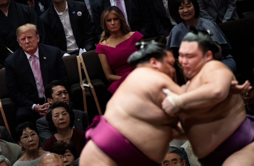 TOPSHOT - US President Donald Trump (L) First Lady Melania Trump (C) and Japan's Prime Minister Shinzo Abe' Akie Abe (R) watch a sumo battle during the Summer Grand Sumo Tournament in Tokyo on May 26, 2019. (Photo by Brendan SMIALOWSKI / AFP) (Photo credit should read BRENDAN SMIALOWSKI/AFP/Getty Images)
