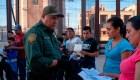 Migrantes esperan en la frontera de Guatemala y México