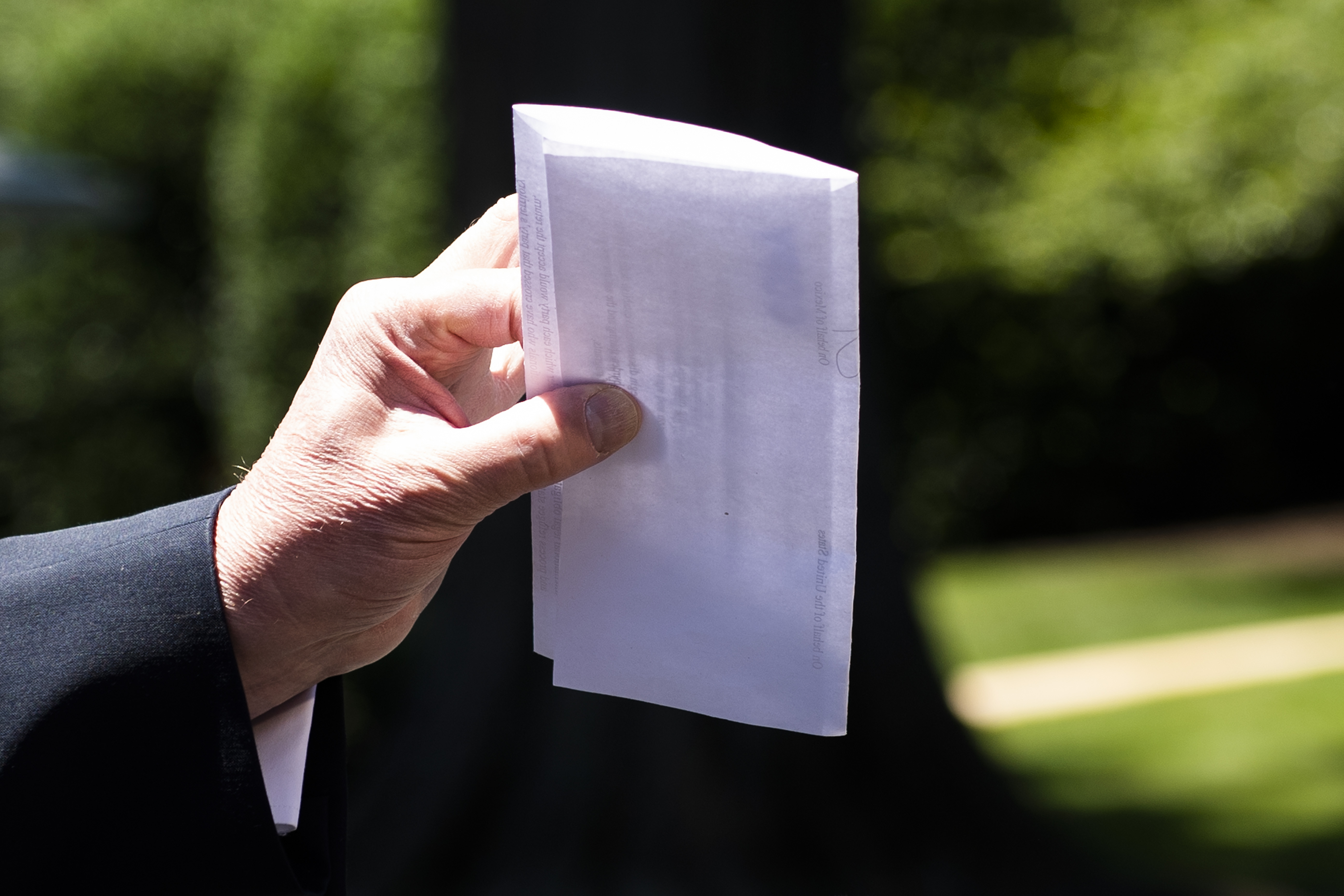 US President Donald Trump holds piece of paper saying its his deal with Mexico as he speaks with reporters at the White House, in Washington, DC, on June 11, 2019. - Trump did not show the paper to reporters. (Photo by Jim WATSON / AFP) (Photo credit should read JIM WATSON/AFP/Getty Images)