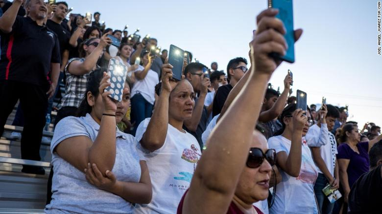 Community members attend a vigil for sophomore Javier Rodriguez, 15, at Horizon High School in Horizon, Texas, Monday, Aug. 5, 2019. Rodriguez was among the 22 killed in the shooting at a Walmart on Aug. 3 in El Paso.