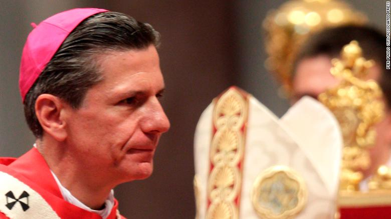 Gustavo Garcia Siller, archbishop of San Antonio, USA, leaves the altar after receiving the pallium from Pope Benedict XVI, a woolen shawl symbolizing his bond to the Pope, in St. Peter's Basilica at the Vatican, Wednesday, June 29, 2011. (AP Photo/Pier Paolo Cito)