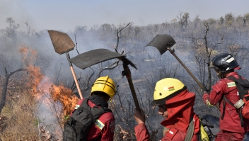 Firefighters try to control a fire near Charagua, Bolivia, in the border with Paraguay, south of the Amazon basin, on August 29, 2019. - Fires have destroyed 1.2 million hectares of forest and grasslands in Bolivia this year, the government said on Wednesday, although environmentalists claim the true figure is much greater. The news comes after leftist President Evo Morales suspended his re-election campaign on Monday to direct the government's response to a growing environmental disaster in the Bolivian portion of the Amazon rainforest, where wildfires have been raging since May. (Photo by AIZAR RALDES / AFP) (Photo credit should read AIZAR RALDES/AFP/Getty Images)