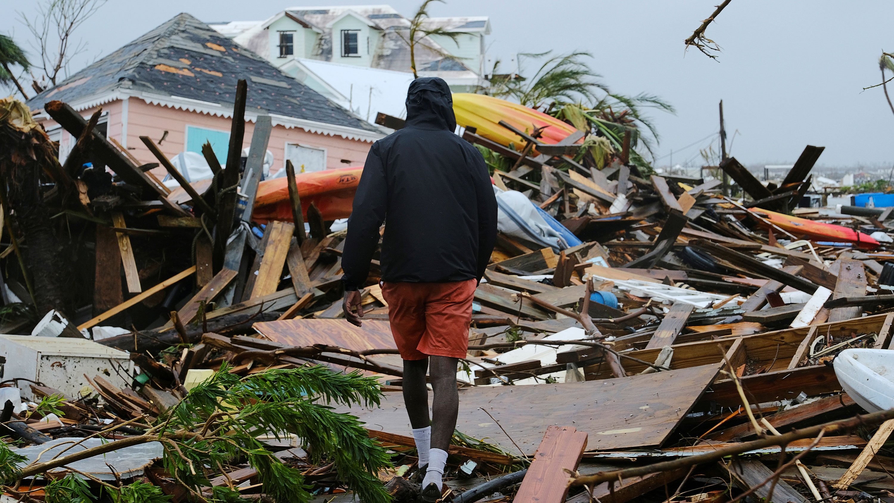 A man walks through the rubble in the aftermath of Hurricane Dorian on the Great Abaco island town of Marsh Harbour, Bahamas, September 2, 2019. Picture taken September 2, 2019. REUTERS/Dante Carrer