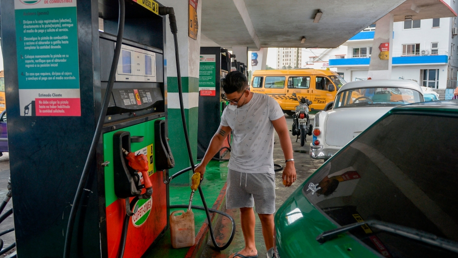 "A man fills a can with fuel at a gas station of Havana, on September 12, 2019. - President Miguel Diaz Canel blamed the United States on Wednesday for Cuba's fuel shortage. In his address, he said the ""low availability of diesel"" will affect transport, merchandise distribution and electricity generation. The US Treasury Department has imposed sanctions on various companies for transporting Venezuelan petroleum to Cuba. (Photo by YAMIL LAGE / AFP) (Photo credit should read YAMIL LAGE/AFP/Getty Images)"
