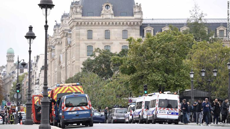 Police vehicles are parked near Paris prefecture de police (police headquarters) after three persons have been hurt in a knife attack on October 3, 2019. (Photo by Martin BUREAU / AFP) (Photo by MARTIN BUREAU/AFP via Getty Images)