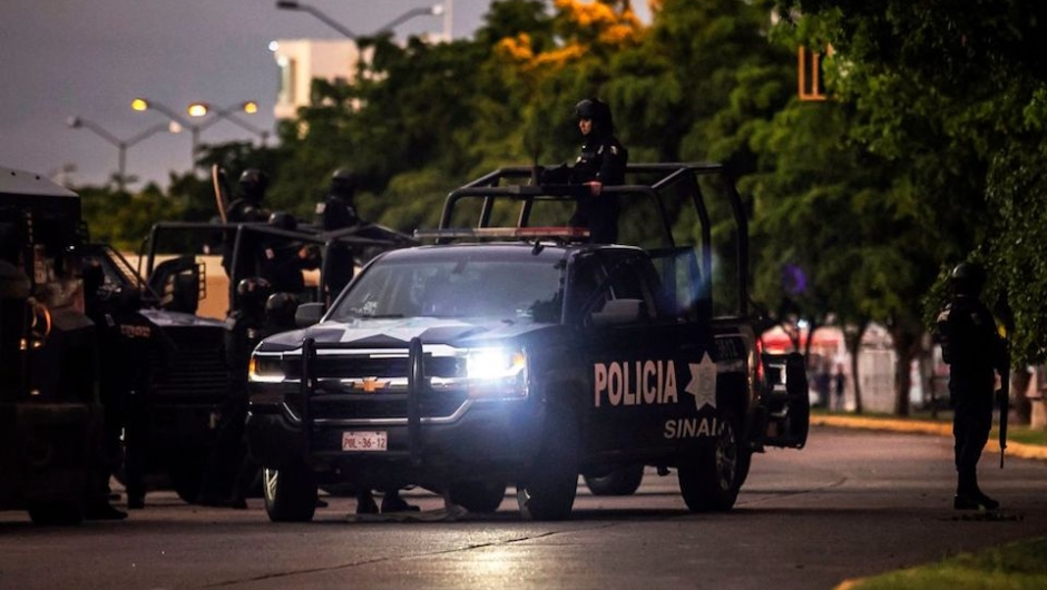 "EDITORS NOTE: Graphic content / Mexican police patrol in a street of Culiacan, state of Sinaloa, Mexico, on October 17, 2019, after heavily armed gunmen in four-by-four trucks fought an intense battle with Mexican security forces. - Mexican security forces on Thursday arrested one son of jailed drug kingpin Joaquin ""El Chapo"" Guzman in an operation that triggered fighting in the western city of Culiacan, Security Minister Alfonso Durazo said. (Photo by RASHIDE FRIAS / AFP) (Photo by RASHIDE FRIAS/AFP via Getty Images)"