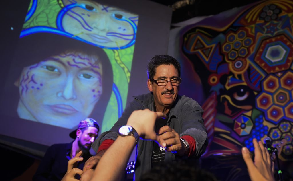 """Colombia's FARC member and singer Julian Conrado performs in a bar during the show """"Fiesta por la Paz"""" (Party for Peace) in Bogota, Colombia on May 1, 2017. / AFP PHOTO / RAUL ARBOLEDA (Photo credit should read RAUL ARBOLEDA/AFP/Getty Images)"""