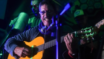"Colombia's FARC member and singer Julian Conrado performs in a bar during the show ""Fiesta por la Paz"" (Party for Peace) in Bogota, Colombia on May 1, 2017. / AFP PHOTO / RAUL ARBOLEDA (Photo credit should read RAUL ARBOLEDA/AFP/Getty Images)"