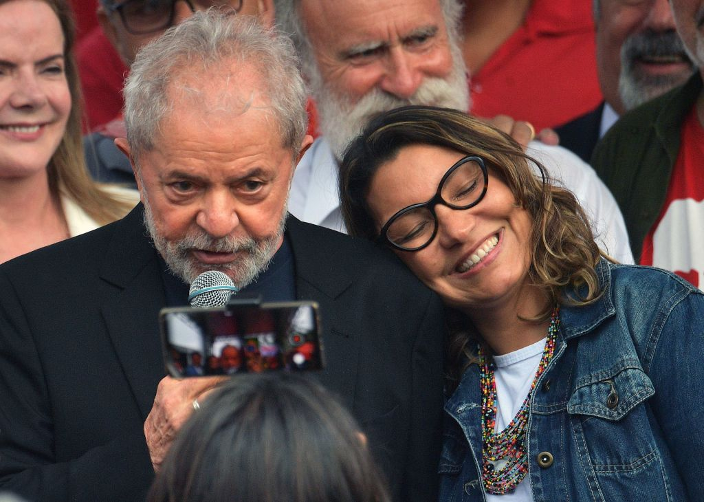 Former Brazilian President Luiz Inacio Lula da Silva speaks to supporters next to his gilfriend Rosangela da Silva after leaving the Federal Police Headquarters, where he was serving a sentence for corruption and money laundering, in Curitiba, Parana State, Brazil, on November 8, 2019. - A judge in Brazil on Friday authorized the release of ex-president Luiz Inacio Lula da Silva, after a Supreme Court ruling paved the way for thousands of convicts to be freed. (Photo by CARL DE SOUZA / AFP) (Photo by CARL DE SOUZA/AFP via Getty Images)