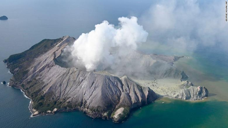 This aerial photo shows White Island after its volcanic eruption in New Zealand Monday, Dec. 9, 2019. The volcano on a small New Zealand island frequented by tourists erupted Monday, and a number of people were missing and injured after the blast. (George Novak/New Zealand Herald via AP)