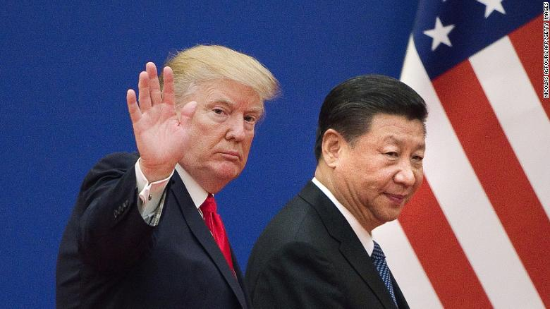 """US President Donald Trump (L) and China's President Xi Jinping leave a business leaders event at the Great Hall of the People in Beijing on November 9, 2017. Donald Trump urged Chinese leader Xi Jinping to work """"hard"""" and act fast to help resolve the North Korean nuclear crisis, during their meeting in Beijing on November 9, warning that """"time is quickly running out"""". / AFP PHOTO / Nicolas ASFOURI (Photo credit should read NICOLAS ASFOURI/AFP via Getty Images)"""