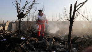 A rescue worker searches the scene where an Ukrainian plane crashed in Shahedshahr, southwest of the capital Tehran, Iran, Wednesday, Jan. 8, 2020. A Ukrainian airplane carrying 176 people crashed on Wednesday shortly after takeoff from Tehran's main airport, killing all onboard. (AP Photo/Ebrahim Noroozi)