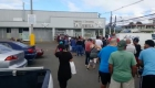 Long lines to buy basic necessities