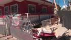 Puertorriqueños lloran por sus casas y negocios derrumbados