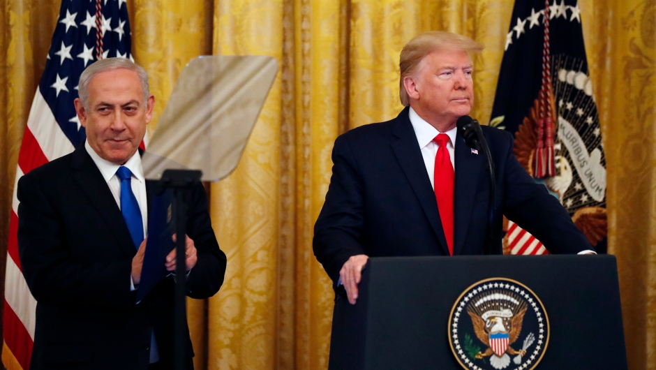 President Donald Trump and Israeli Prime Minister Benjamin Netanyahu arrive for a ceremony in the East Room of the White House, Tuesday, Jan. 28, 2020, in Washington. (AP Photo/Alex Brandon)