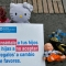 "Toys are displayed next to a sign reading ""Teach your children not to accept presents in exchange of favours"" at the Bolivar square in Bogota, on November 20, 2019, as part of a campaign to raise awareness against child abuse during the universal Children's Day. - World Children's Day was first established in 1954 and is celebrated on November 20th to promote international awareness among children worldwide and improving their welfare. (Photo by Raul ARBOLEDA / AFP) (Photo by RAUL ARBOLEDA/AFP via Getty Images)"