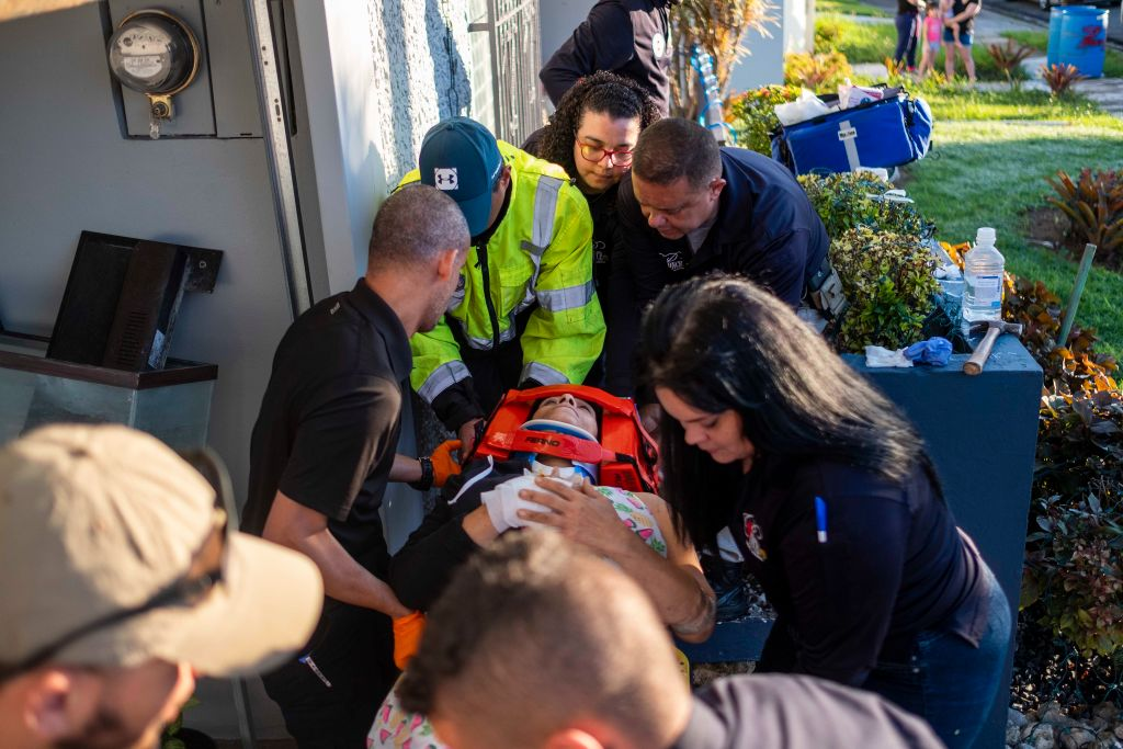 Paramedics carry away a patient on a stretcher that was injured after a earthquake hit the island in Ponce, Puerto Rico on January 7, 2020. - A strong earthquake struck south of Puerto Rico early January 7, 2020 followed by major aftershocks, the US Geological Survey said, the latest in a series of tremors that have shaken the island since December 28. The shallow 6.4 magnitude quake struck five miles (eight kilometers) south of the community of Indios, the USGS said, revising down its initial reading of 6.6. (Photo by Ricardo ARDUENGO / AFP) (Photo by RICARDO ARDUENGO/AFP via Getty Images)