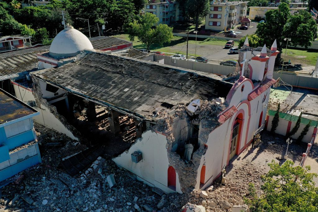 The Inmaculada Concepcion church, built in 1841, is seen partially collapsed after an  earthquake hit the island in Guayanilla, Puerto Rico on January 7, 2020. - A strong earthquake struck south of Puerto Rico early January 7, 2020 followed by major aftershocks, the US Geological Survey said, the latest in a series of tremors that have shaken the island since December 28. The shallow 6.4 magnitude quake struck five miles (eight kilometers) south of the community of Indios, the USGS said, revising down its initial reading of 6.6. (Photo by Ricardo ARDUENGO / AFP) (Photo by RICARDO ARDUENGO/AFP via Getty Images)