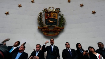 "Venezuelan opposition leader and self-proclaimed acting president Juan Guaido speaks at the National Assembly, in Caracas, on January 7, 2020. - Opposition leader Juan Guaido and a rival lawmaker, Luis Parra -who both had claimed to be Venezuela's parliament speaker, following two separate votes and accusations of a ""parliamentary coup- called for a parliamentary session today. (Photo by Federico Parra / AFP) (Photo by FEDERICO PARRA/AFP via Getty Images)"