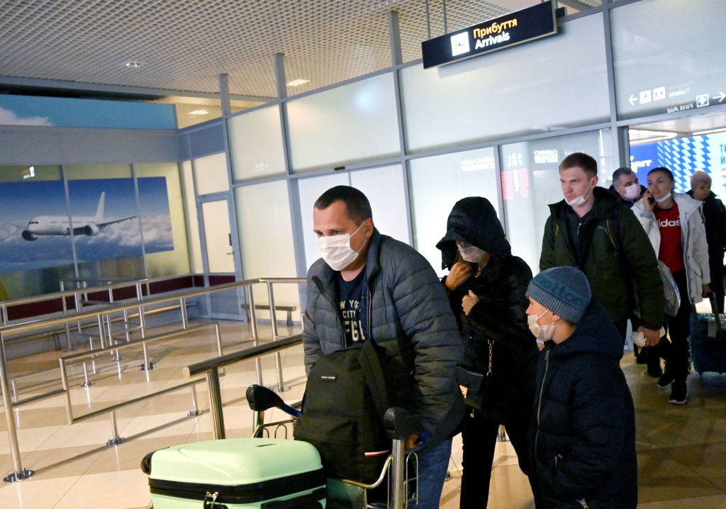 Ukrainian tourists walk in the arrival hall of the Internatioanal Boryspil airport outside Kiev after their plane landed from China on January 30, 2020. - The first out of four special flights will be held on January 30, 2020 in order to evacuate hundreds of Ukrainian tourists from China as a deadly coronavirus outbreak grows. With no regular flights between Ukraine and China, two Ukrainian airlines, SkyUp and Ukraine International Airlines, provide charter transportation for holidaymakers to the seaside resort of Sanya on the Hainan island, but they announced a suspension of transportation after the epidemic has killed more than 130 people and spread around the world. (Photo by Sergei SUPINSKY / AFP) (Photo by SERGEI SUPINSKY/AFP via Getty Images)