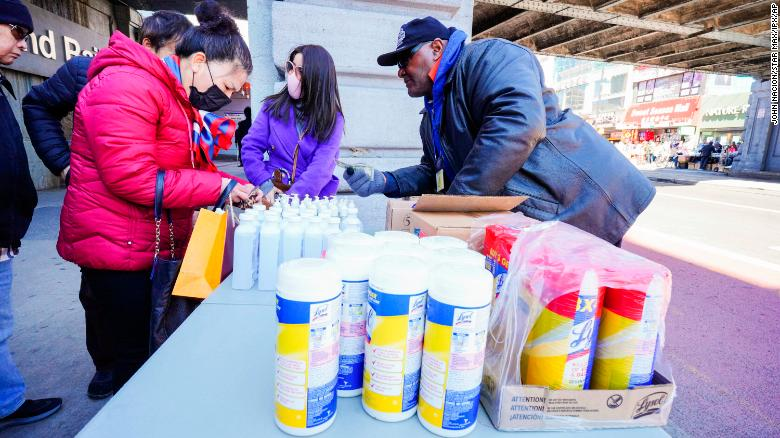 Photo by: John Nacion/STAR MAX/IPx 2020 3/4/20 People wear protective masks to fend off the Corona Virus, while street vendors pedal masks, hand sanitizer and other disinfecting products in Queens, New York.