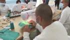 Jóvenes reclusos fabrican miles de mascarillas en Guatemala
