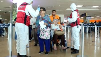 Health workers check passengers arriving at Mariscal Sucre International Airport regarding the spread of the COVID-19 virus worldwide, in Quito, on March 1, 2020. - Ecuador confirmed on the eve its first case of the COVID-19. (Photo by Cristina Vega Rhor / AFP) (Photo by CRISTINA VEGA RHOR/AFP via Getty Images)