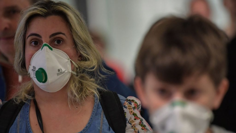 Passengers wearing masks as a precautionary measure to avoid contracting the new coronavirus, COVID-19, arrive on a flight from Italy at Guarulhos International Airport, in Guarulhos, Sao Paulo, Brazil on March 2, 2020. - The death toll from the new coronavirus epidemic surpassed 3,000 on Monday. The virus has now infected more than 89,000, spread to over 60 countries and threatens to cause a global economic slowdown -- after first emerging in China late last year. (Photo by Nelson ALMEIDA / AFP) (Photo by NELSON ALMEIDA/AFP via Getty Images)